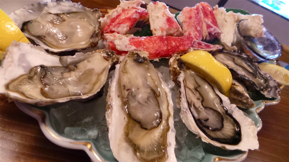A plate of fresh oysters and super sweet hokkaido crab legs