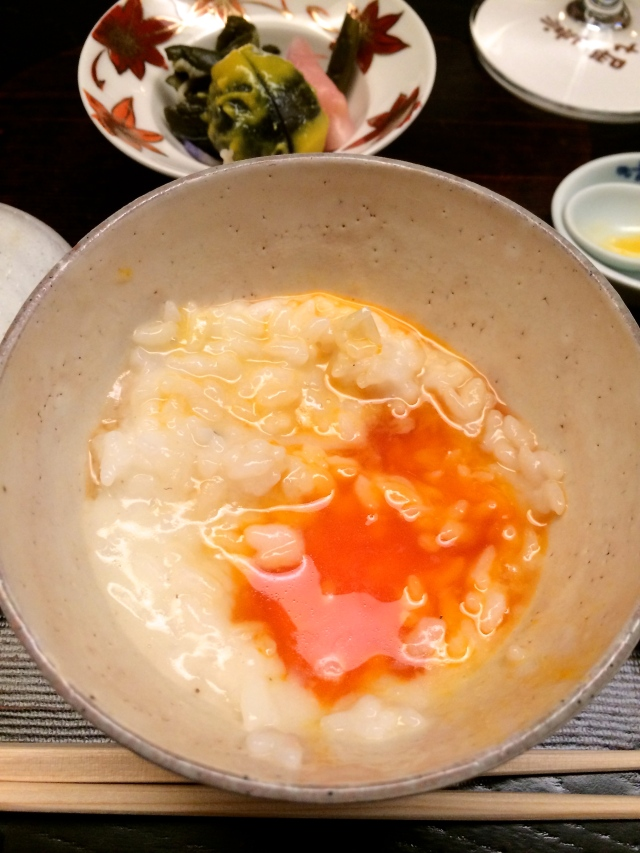 Truffle scented rice porridge with poached eggs